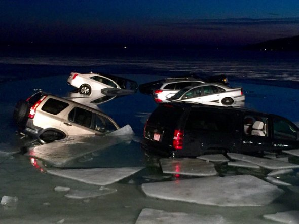 2/6/16 Milwaukee Journal Sentinel - Cars remain submerged in Geneva Lake in the twilight hours Saturday.